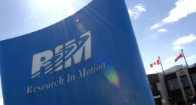 Research in Motion posts $235 million loss, beats street expectations, shares gain 22%